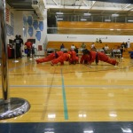 Karate students doing knuckle push ups.